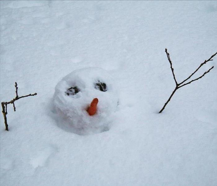 Snowman Burried in snow